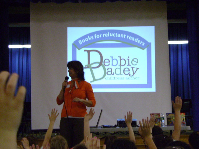 Debbie visiting a school.
